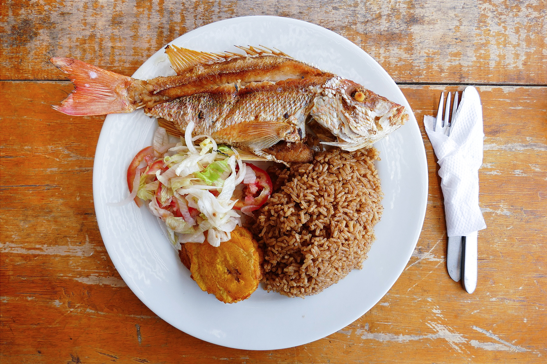 """When you order """"lunch"""" (no menu) at Los Flamencos, you get a whole fried fish with patacones (fried plantains) and rice. Noah Strycker"""