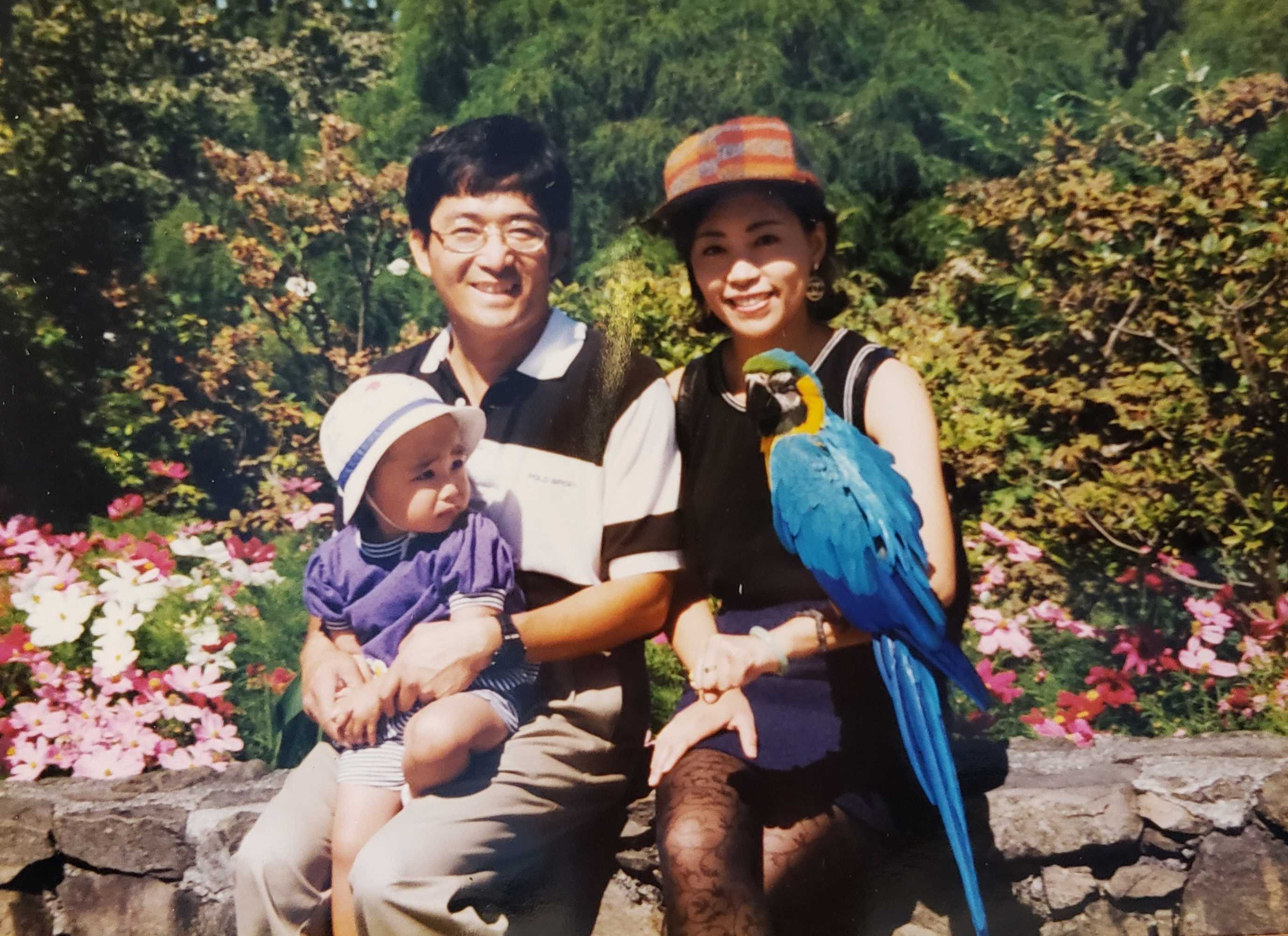 """Lin, with her parents, and the aforementioned """"giant colorful monster"""". Courtesy of Christine Lin"""