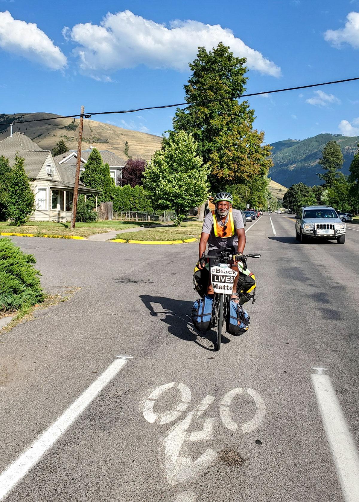 Edwards biking through Missoula. Dr. Ellie Steinberg