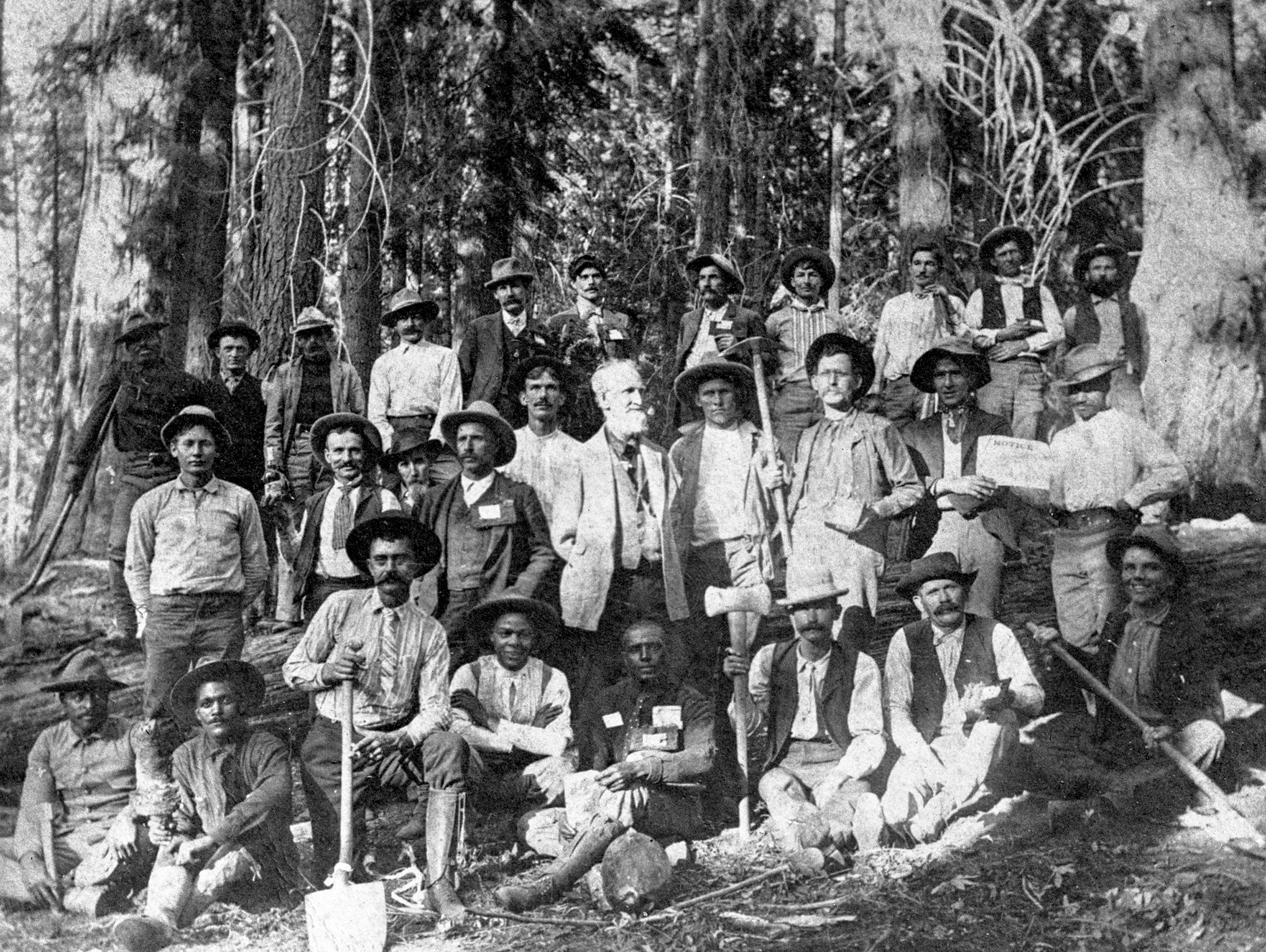 Young, bottom center, and road construction crew upon completion of road into Giant Forest in Sequoia National Park, 1903. National Park Service