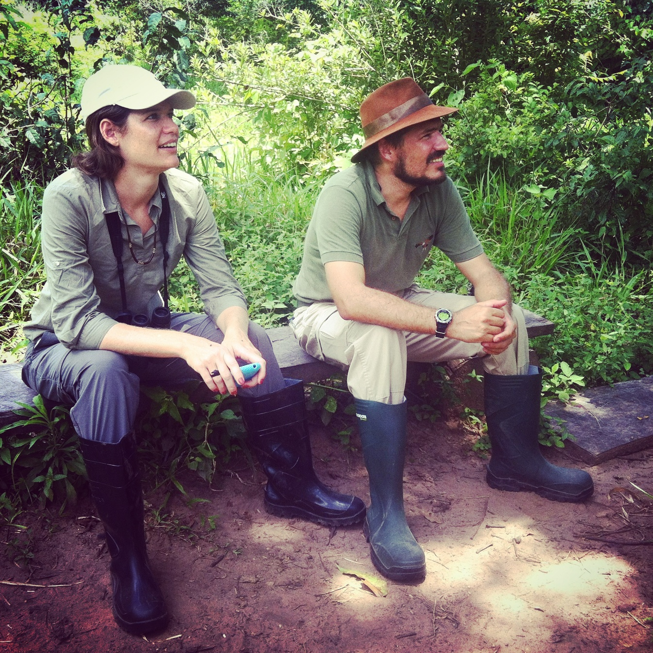 Bianca and Giuliano sit in the shade while waiting to spot the Harpy Eagle. Credit: Noah Strycker