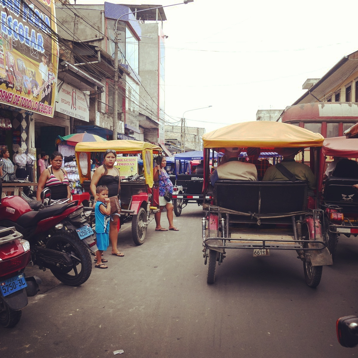 The streets of Iquitos, Peru are jammed with motorcycles, mototaxis, people, animals, and everything in between. Noah Strycker