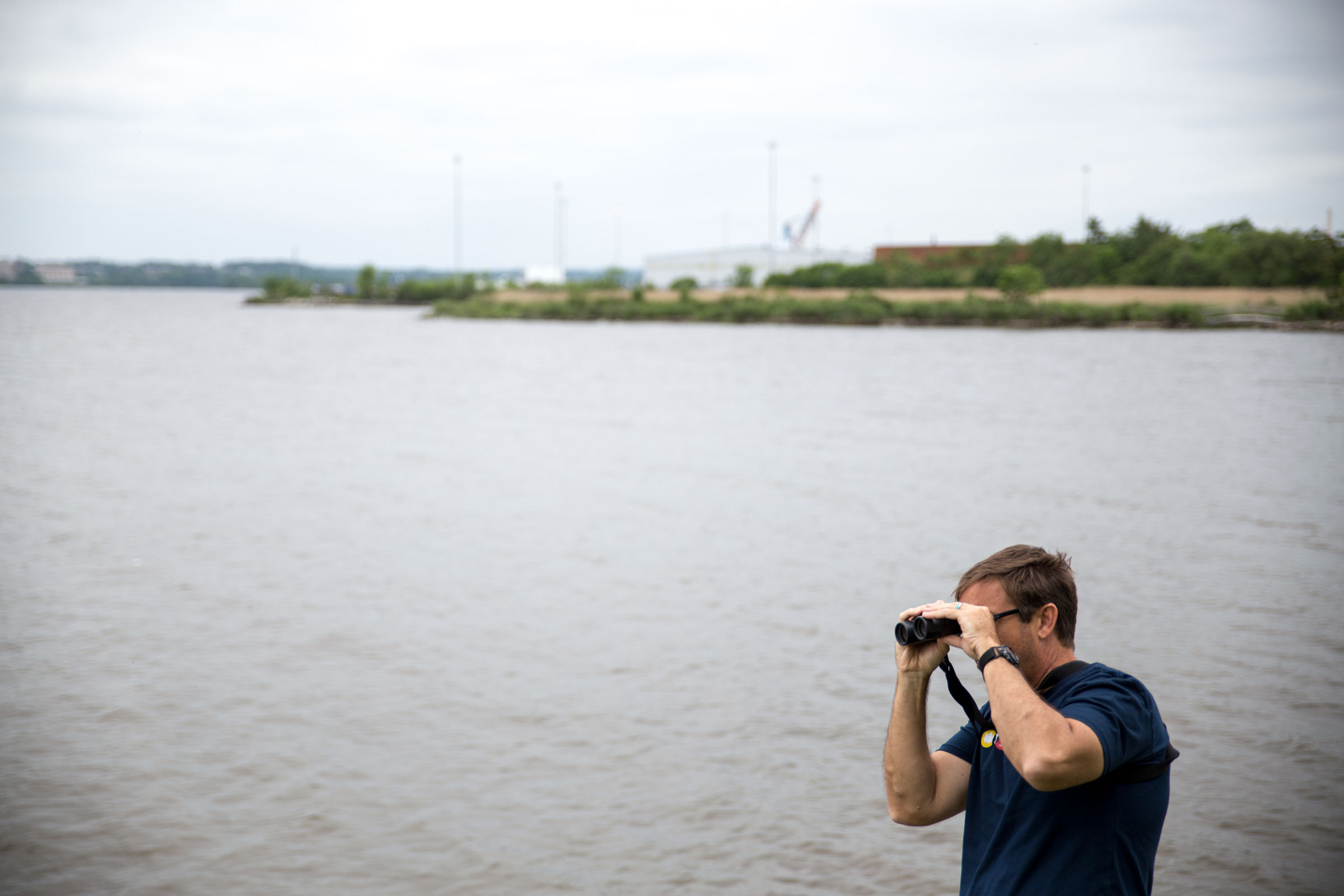 A festival goer scopes out a tiny Spotted Sandpiper along the harbor of Fort McHenry. More than 260 species have been recorded at the centuries-old monument and shrine. Camilla Cerea/Audubon