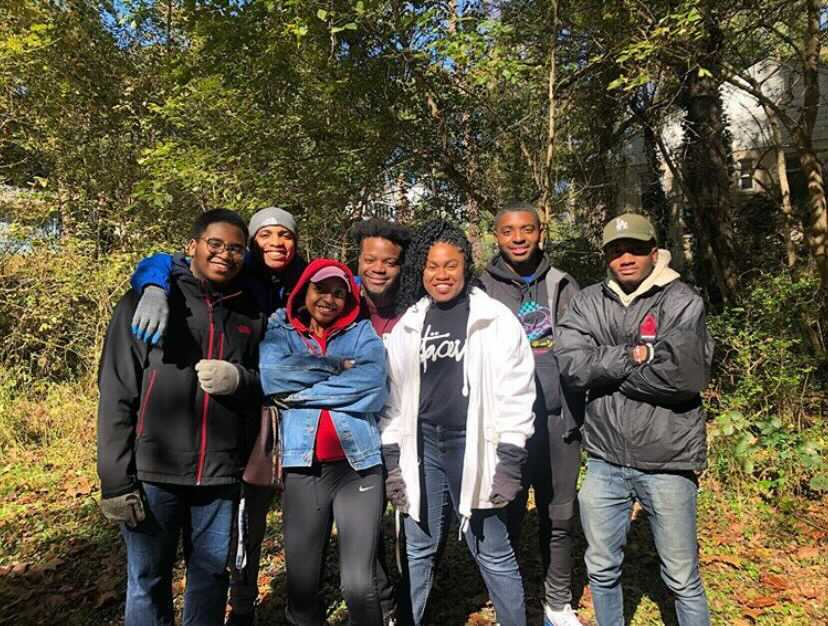 Bellamy, center, along with friends and fellow members of the Morehouse Moregreen environmental chapter at Morehouse College. Courtesy of Josh Bellamy