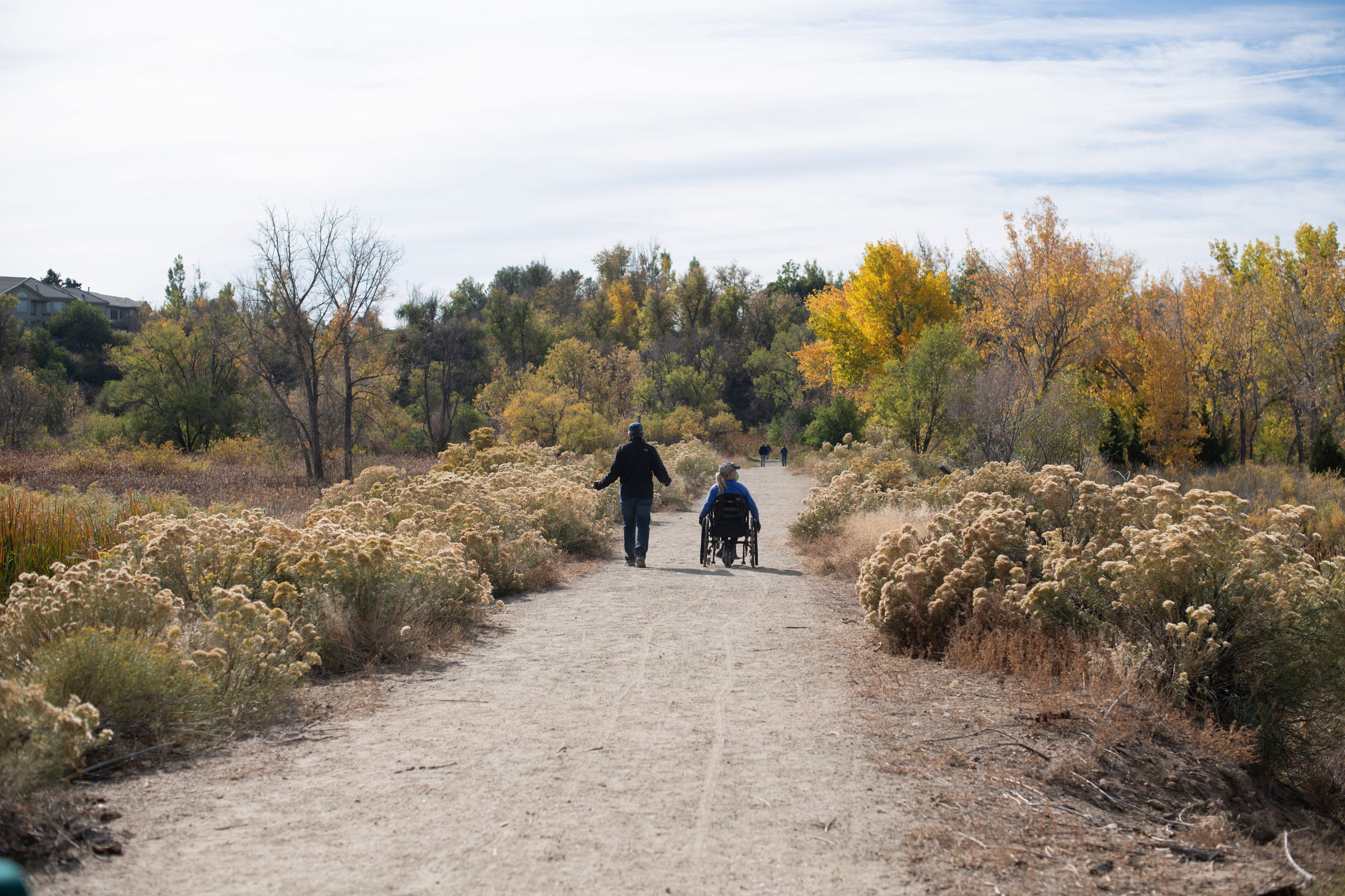 Karl Brummert (left) and Chris Layne (right) make their way through Prospect Park, one of three parks in Denver that Roark has identified as wheelchair friendly enough for serious birding. Rachel Woolf