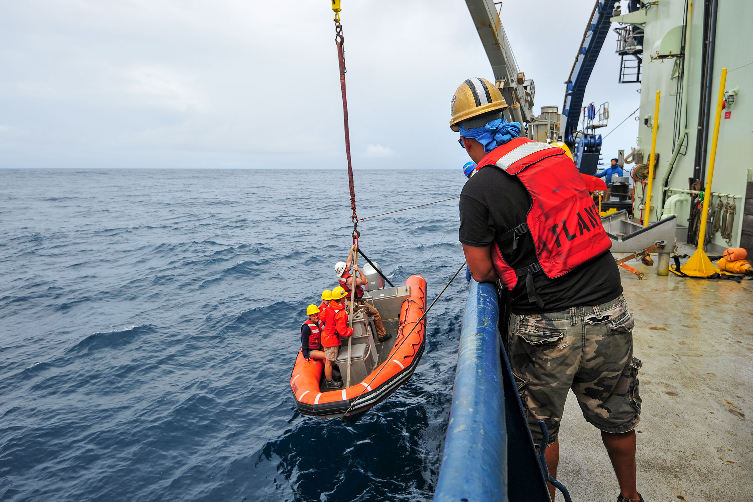 The small boat is lowered over the side of the research vessel to aid in recovery of the human-occupied vehicle Alvin and transfer crew and scientists from shore. Shana Goffredi