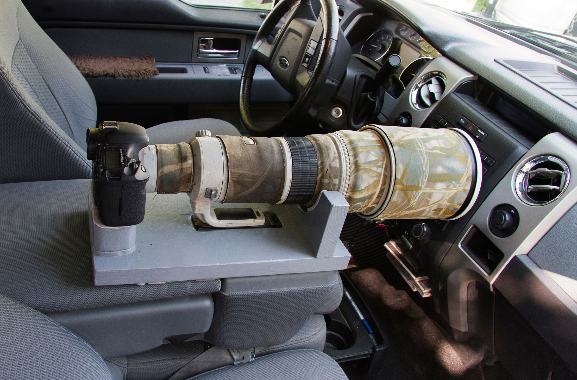 A DIY lens caddy for the center console keeps your setup secure while driving. Ron Dudley