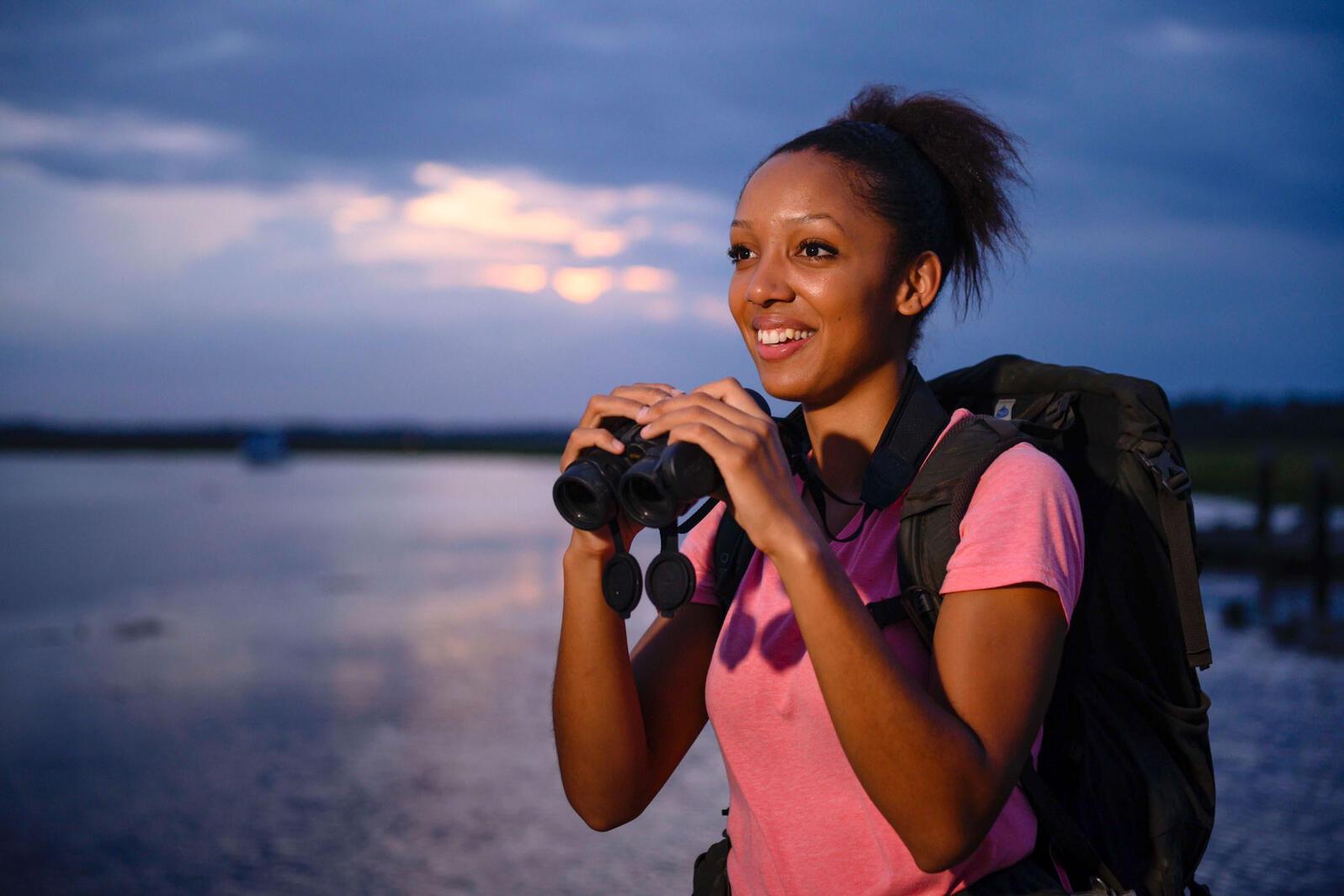 Corina Newsome birding along the Savannah River in Georgia. Katherine Arntzen/Georgia Southern University