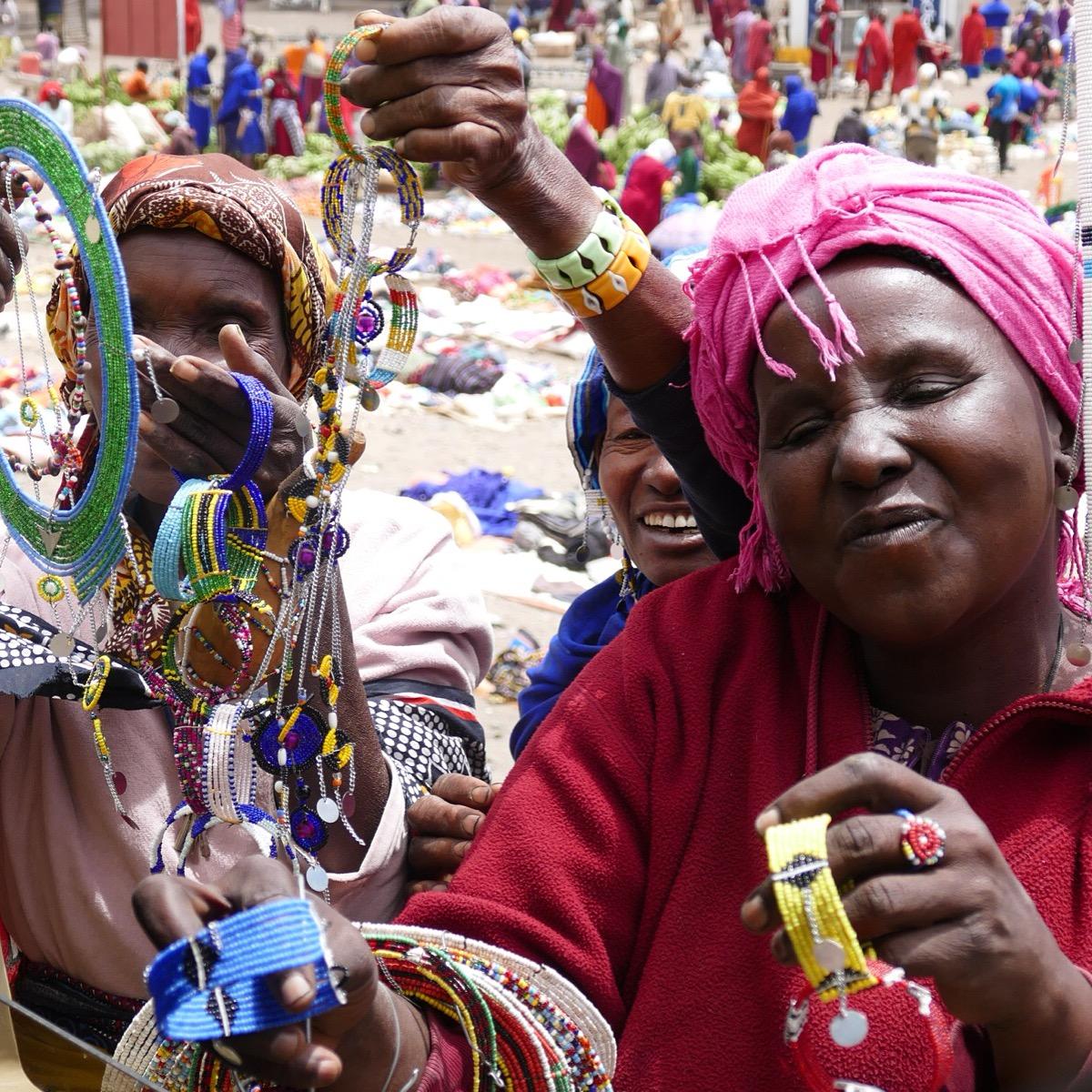 Maasai women gather to sell souvenirs en route to the Serengeti. Noah Strycker