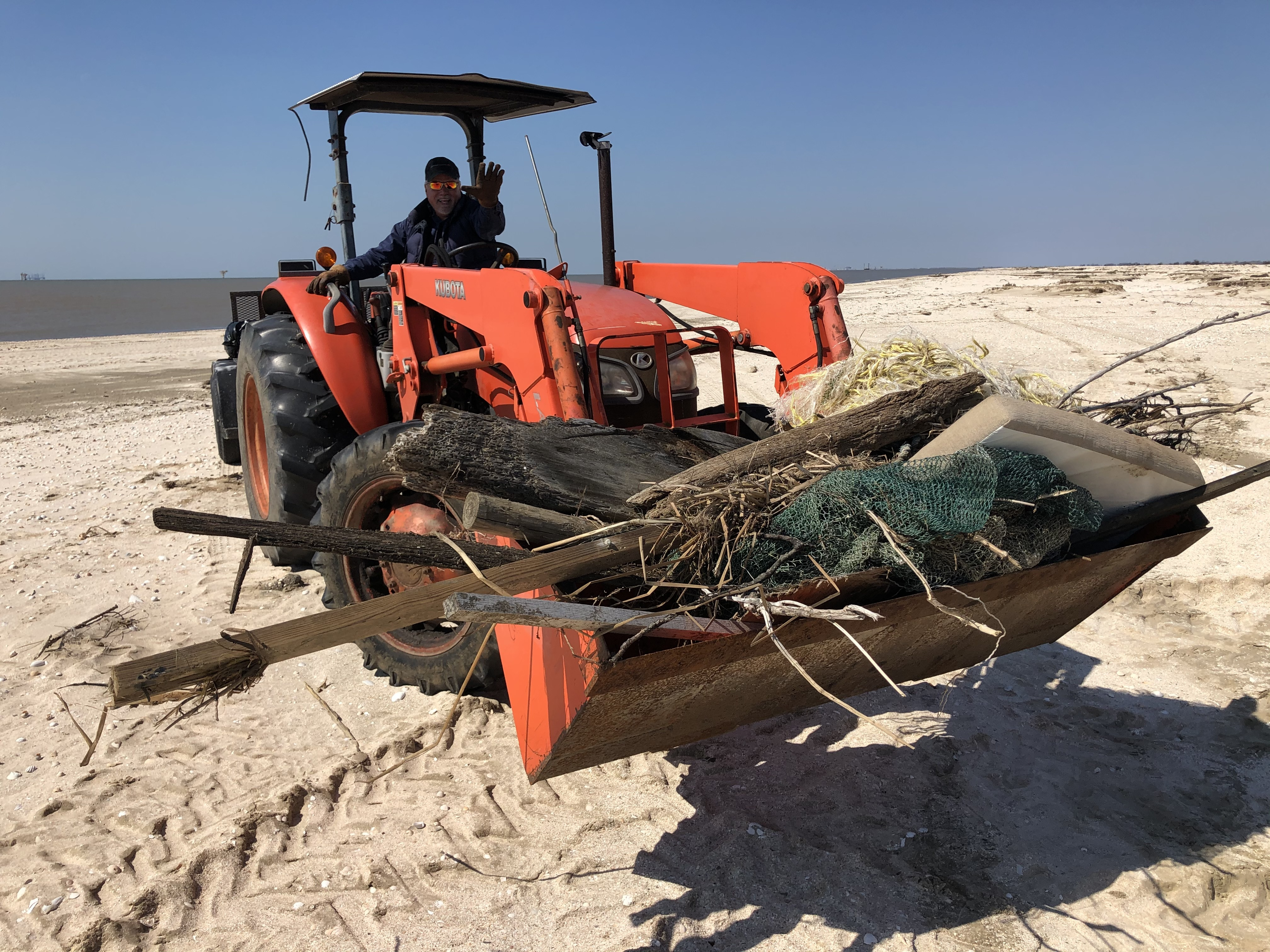 Cameron Parish President and Police Juror for District 5, Scott Trahan, removes large debris from Rutherford Beach with the help of his tractor. Katie Barnes/Audubon Louisiana