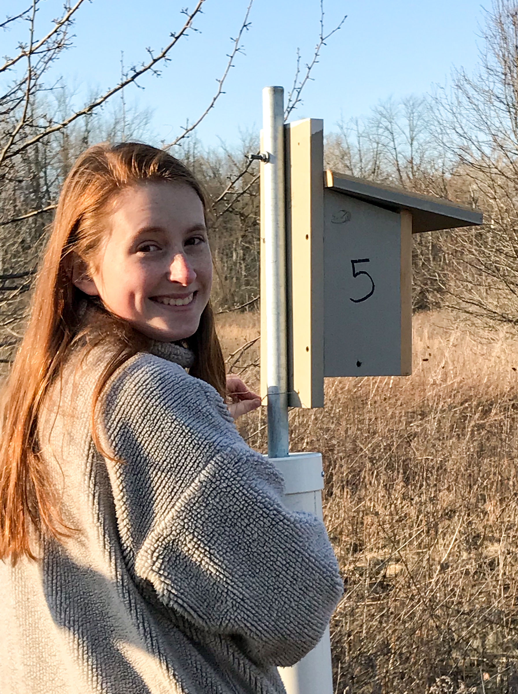 The writer with one of her six nest boxes this spring. Courtesy of Katelyn Shelton