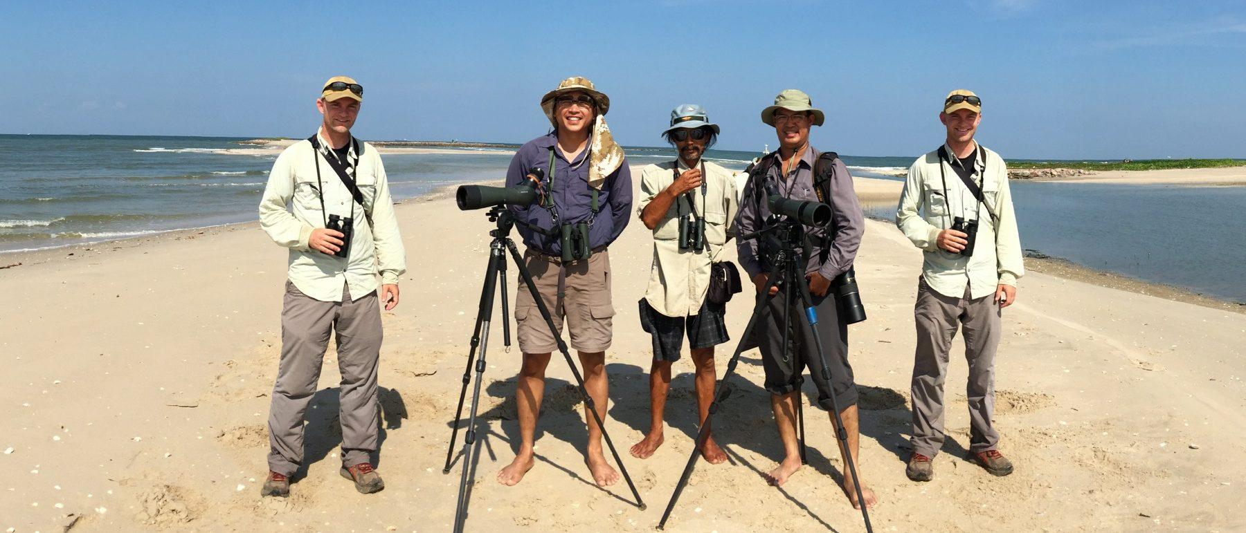 Noah is beside himself with birding friends in Thailand. Panuwat Sasirat