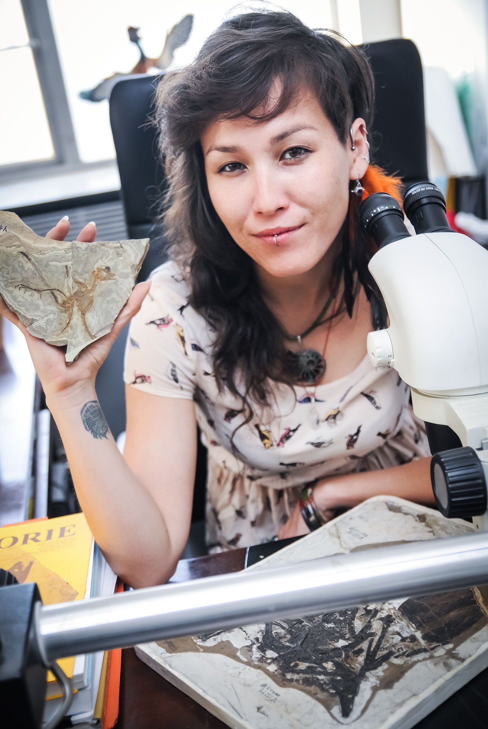 Jingmai O'Connor, a coauthor of the new study, in her lab with a fossil bird. Jingmai O'Connor/Chinese Academy of Sciences