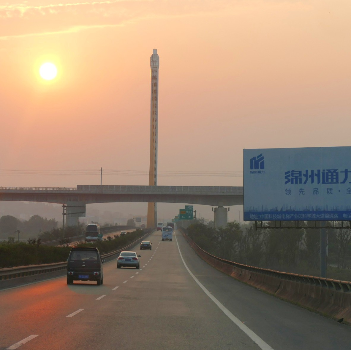 The spire of a large, recently built bridge looms against the sunset. Noah Strycker
