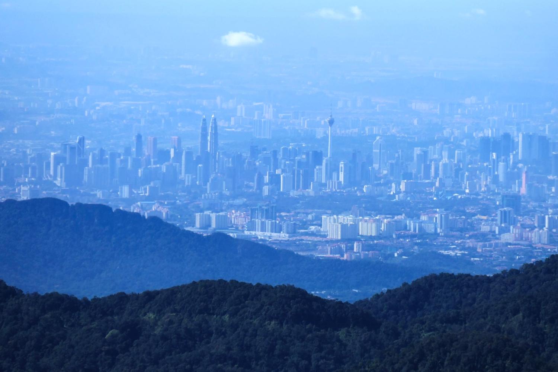 Skyscrapers in Kuala Lumpur crowd the landscape below. Noah Strycker