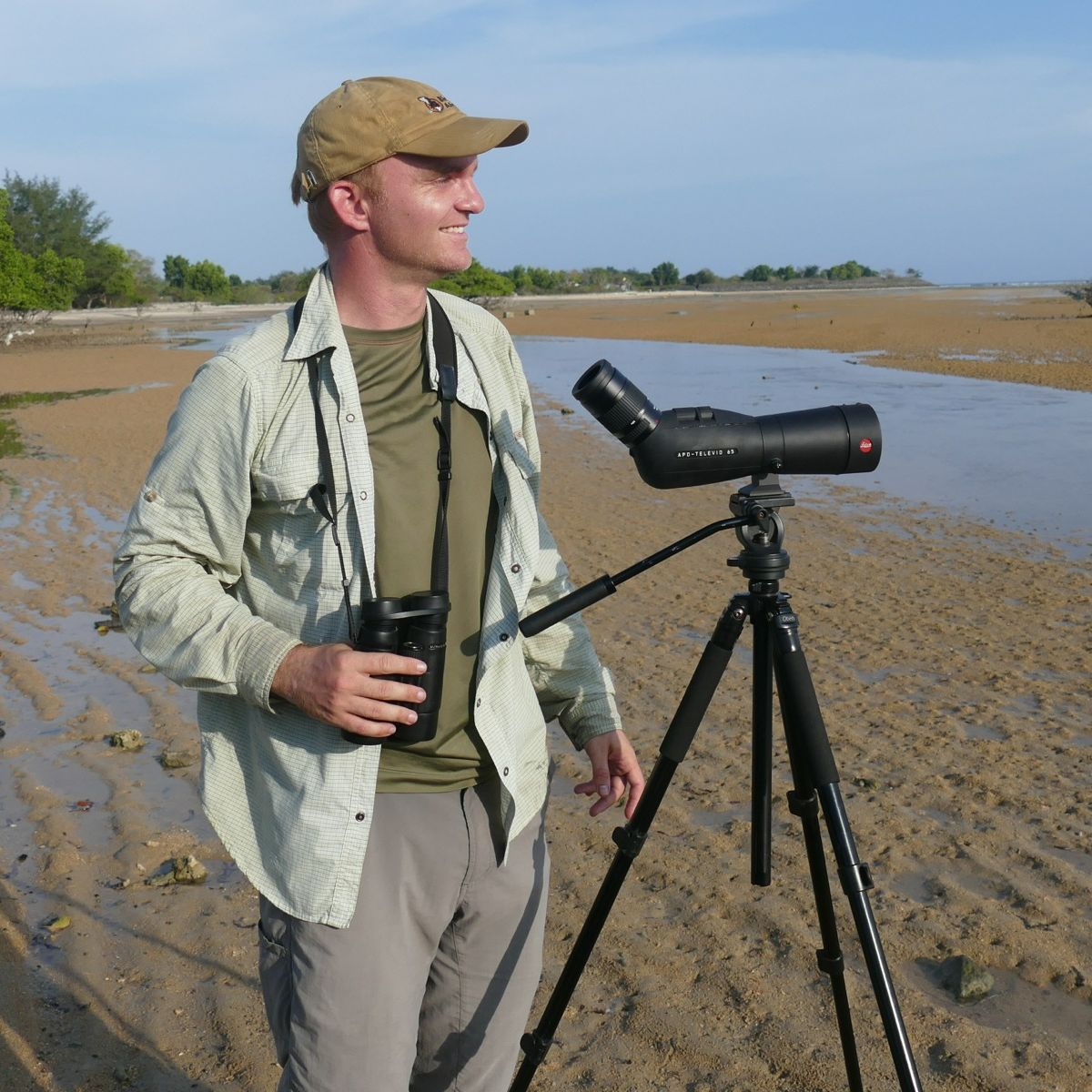 Noah scans for shorebirds at a lagoon near Denpasar. Noah Strycker