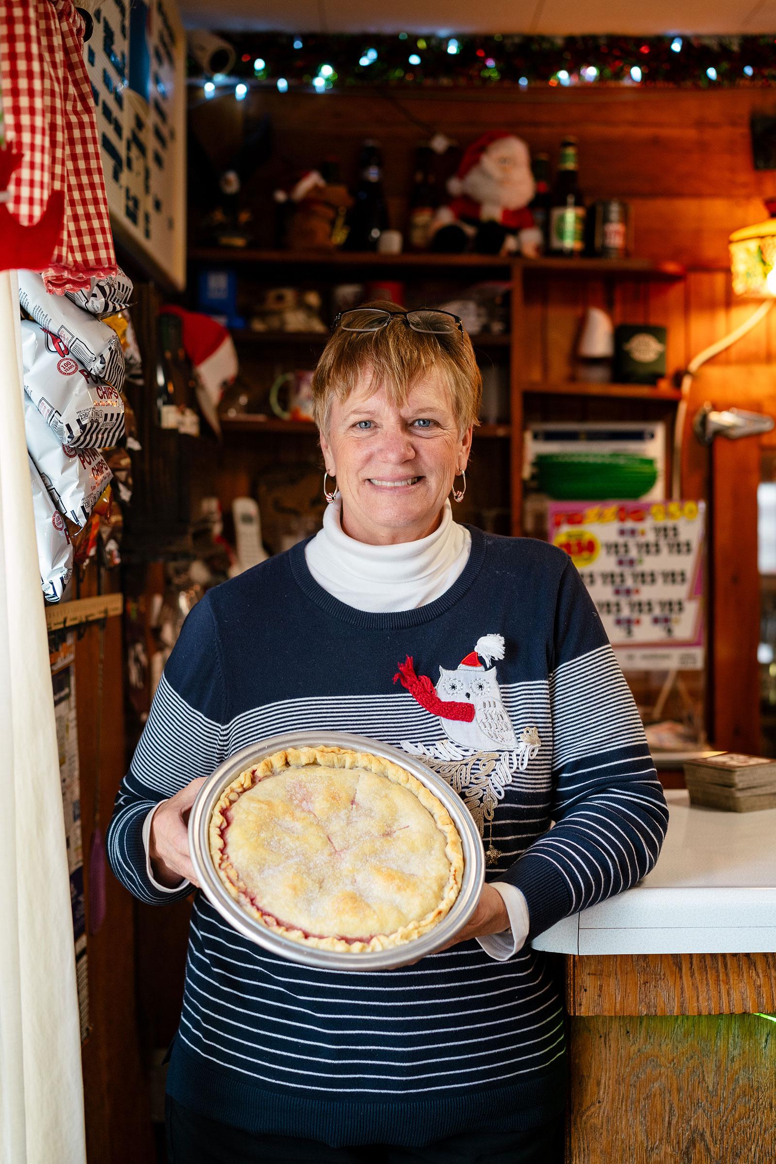 Brenda Lowe with a fresh-baked Cherry-Berry Pie. Nick Hagen