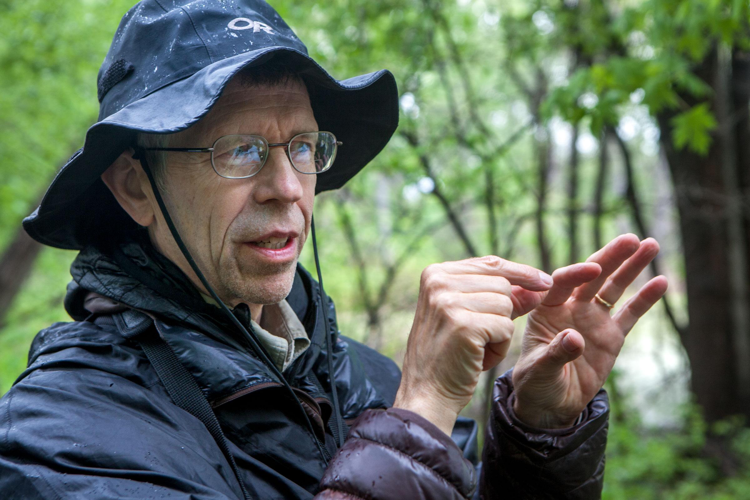 Author Tom Stephenson explaining bird calls in the field. Camilla Cerea/Audubon