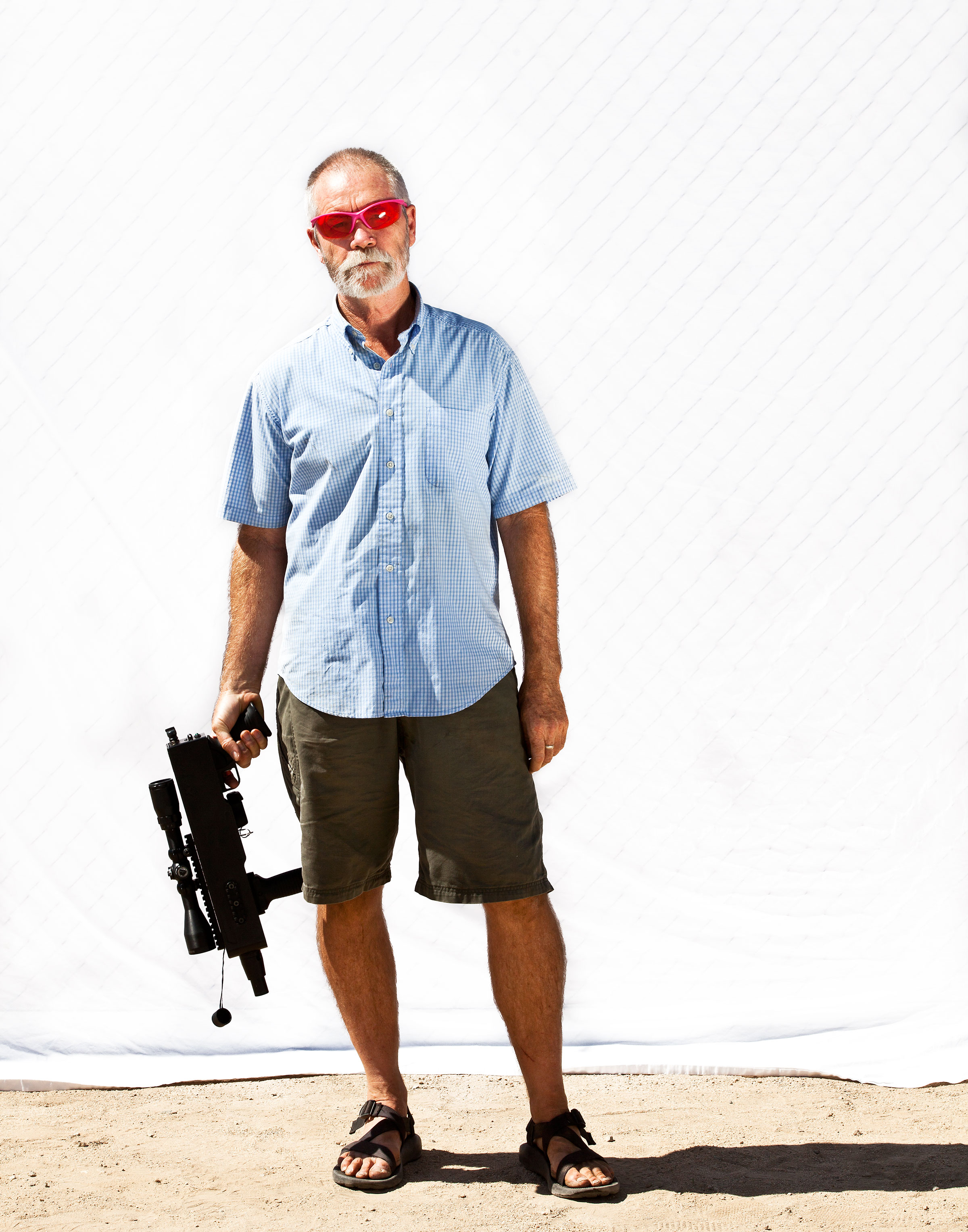 Tim Shields, with his laser, is on a mission to protect desert tortoises from predatory ravens. Tom Fowlks
