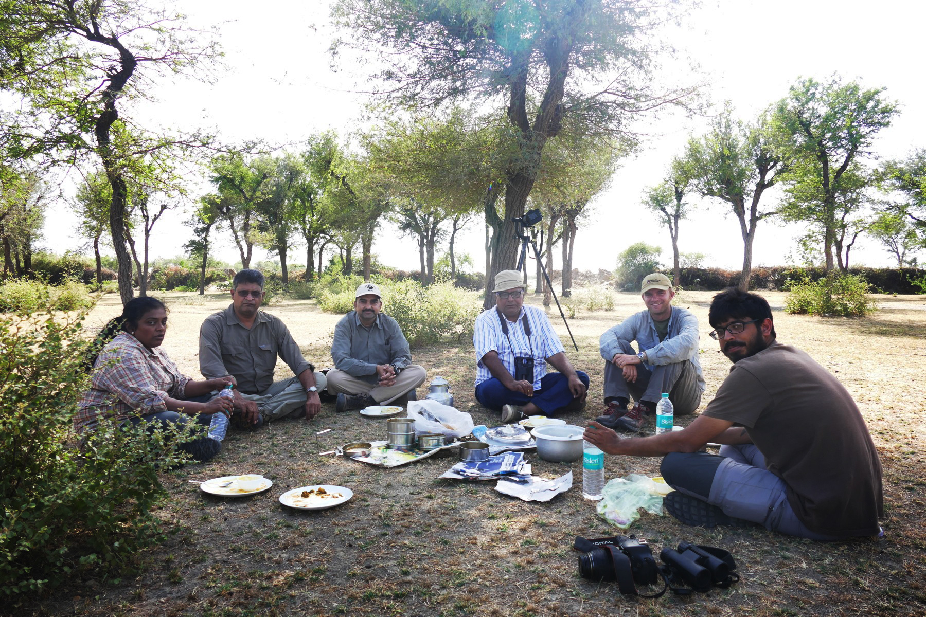 Padmini, Badri, Dhanajai, Poonia, Noah, and Ramit take an afternoon picnic. Noah Strycker