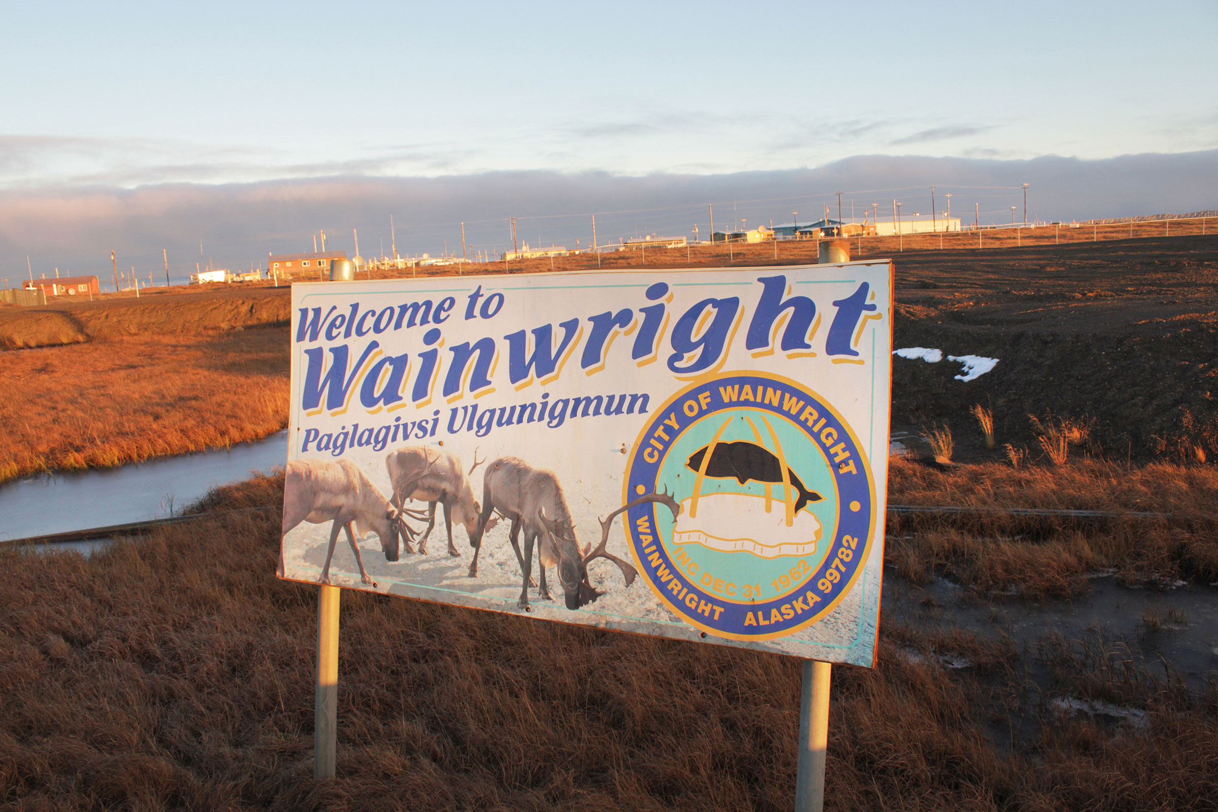 A sign welcomes visitors in both English and Iñupiaq. Madeline Ostrander