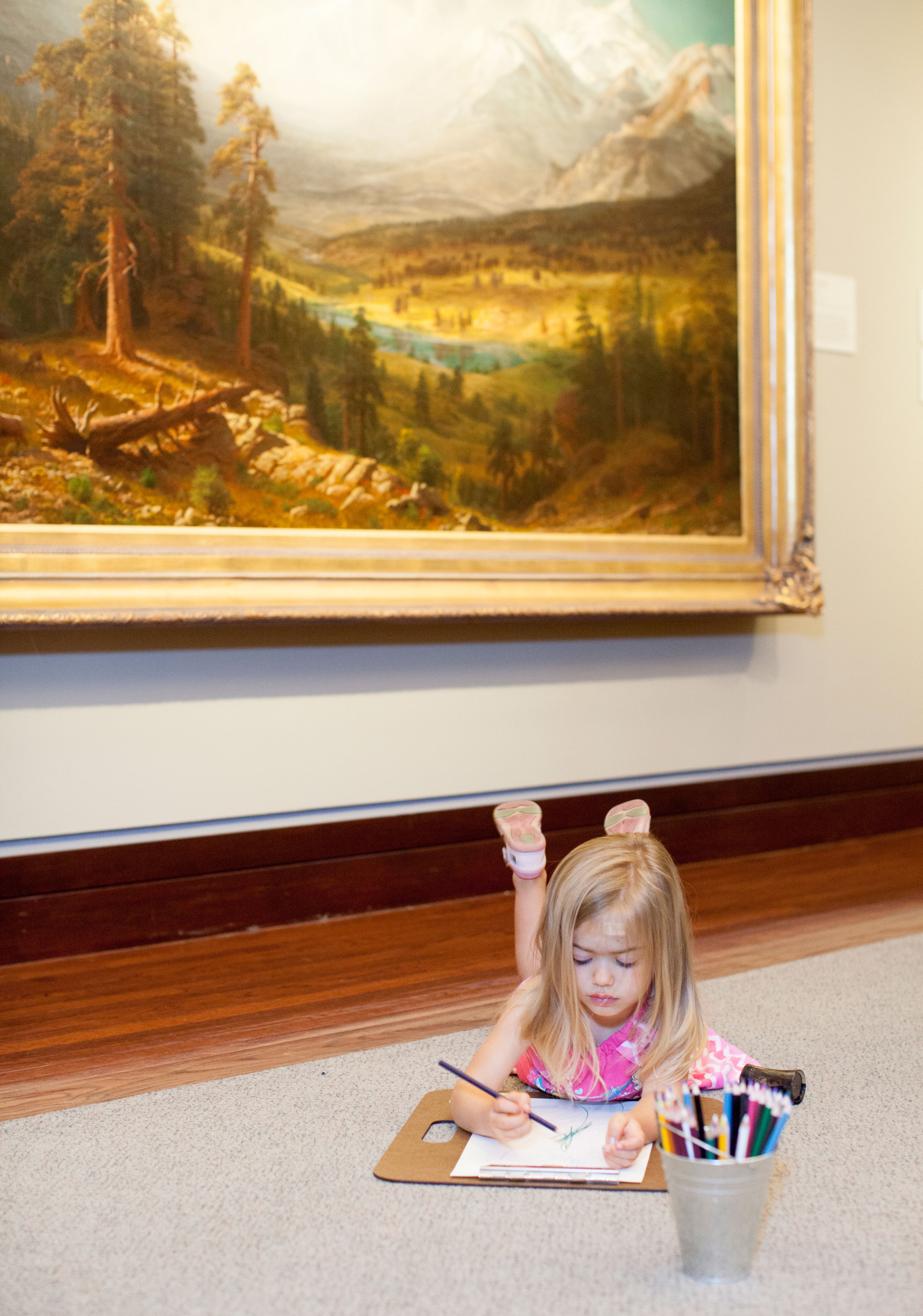 """A young visitor participates in Audubon Rockies' """"Art Inspired By Nature"""" coloring activity in the Denver Art Museum. Morgan Rachel Levy"""