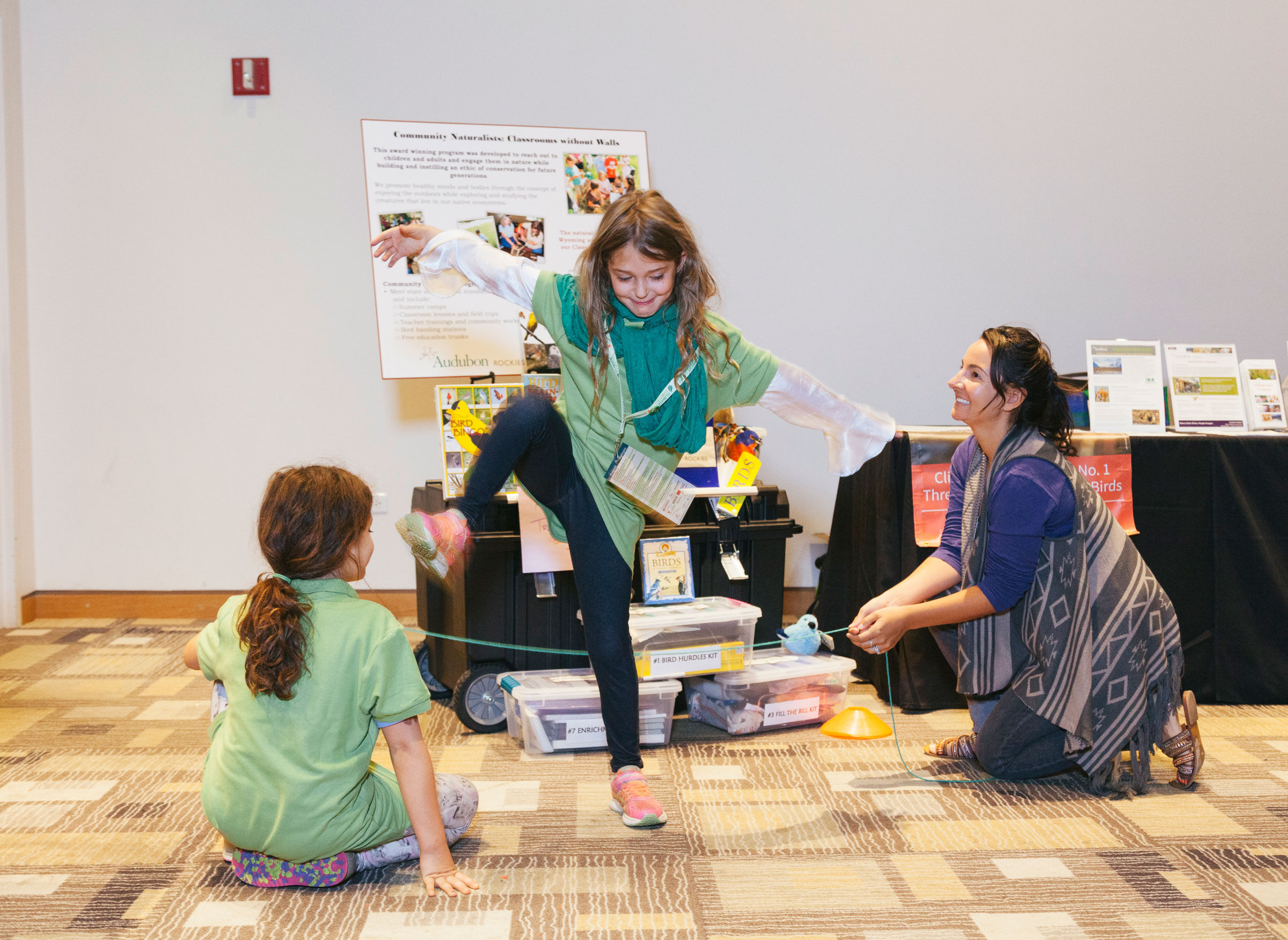 """Two visitors participate in an activity from Audubon Rockies' """"Bird Hurdle Kit,"""" one of many learning games in the Birds and Climate Educational Traveling Trunk. Morgan Rachel Levy"""