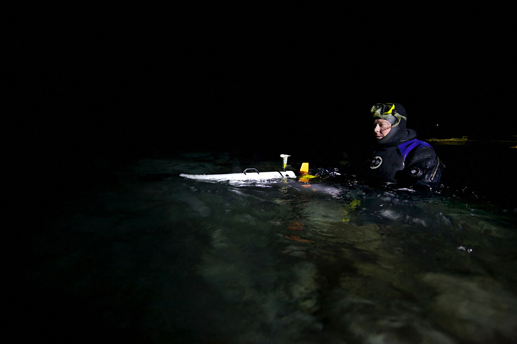 Project leader Jorgen Berge launches an underwater robot that measures temperature, salinity, and density. Geir Johnsen/NTNU