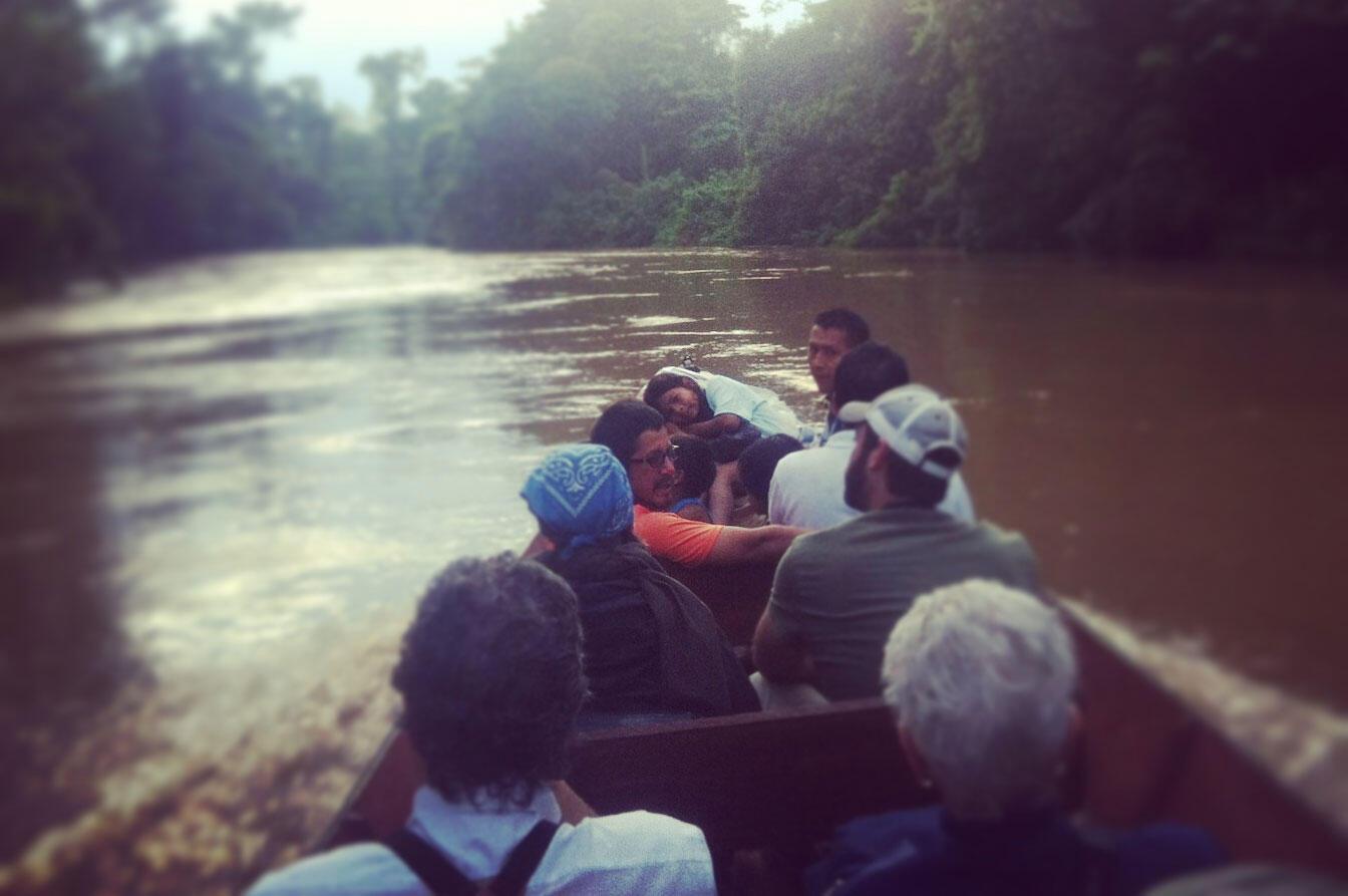 Heading down the Shiripuno River in a motorized canoe, Ecuador. Noah Strycker
