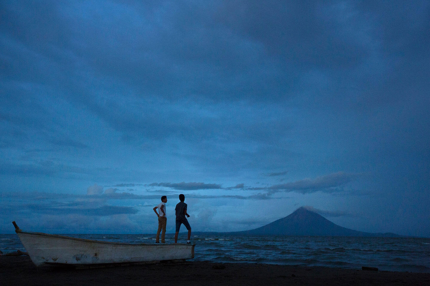 Steven and Alex Herrera (13 and 14) play on a fishing boat off Lake Nicaragua. If the canal proceeds as planned, it will cut through the lake and put the surrounding habitat at risk. Ivan Kashinsky