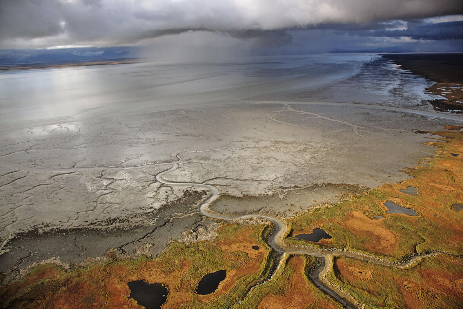 Dark clouds converge over Nushagak Bay, in one of the pristine watersheds that would be threatened by the proposed mine and its toxic tailings ponds. Photograph by Michael Medford/National Geographic Stock