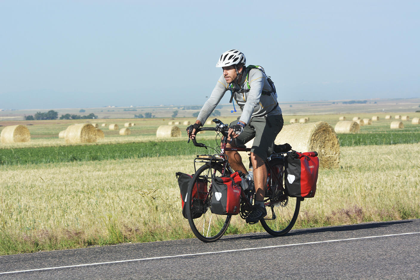 Dorian Anderson on his bike, as he attempts to complete a Big Year with limited carbon emissions. Image credit to Bill Schmoker.