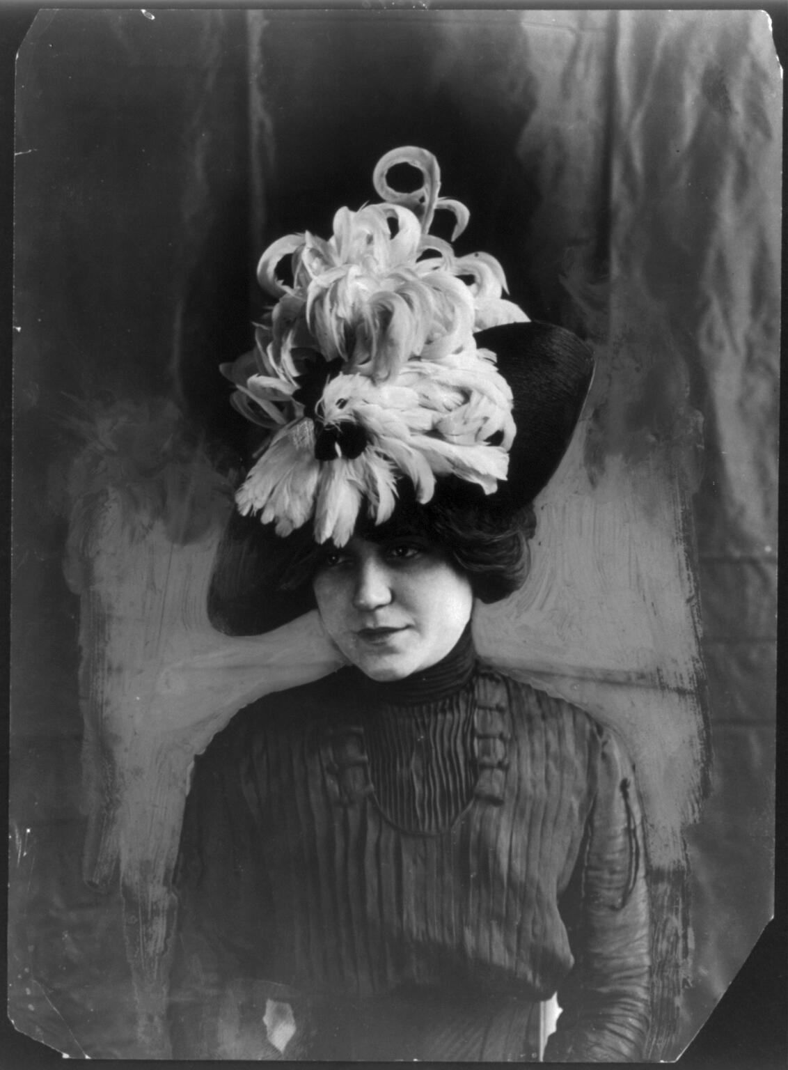 """A woman wears a """"Chanticleer"""" hat of bird feathers, circa 1912. George Grantham Bain Collection/Library of Congress"""