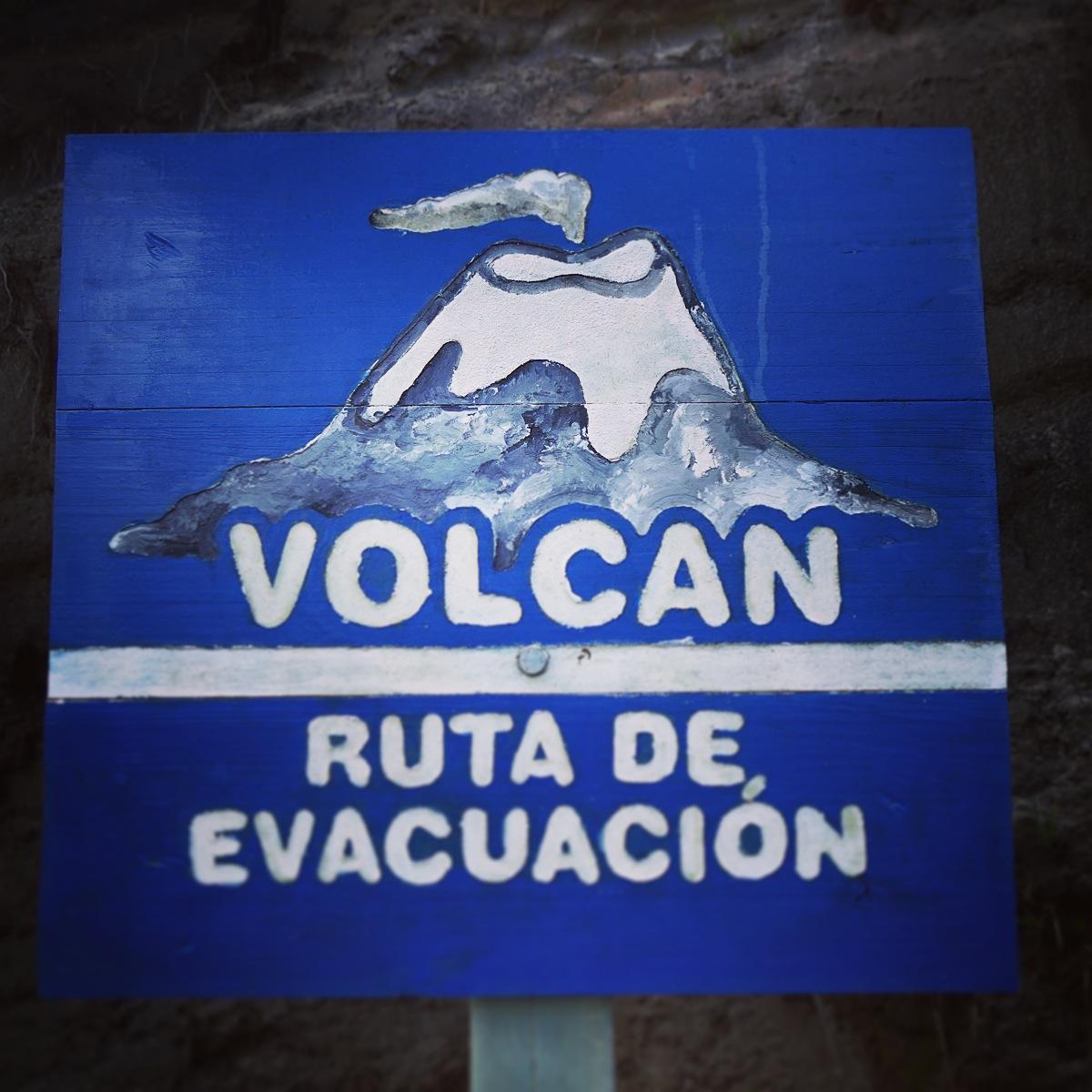 Evacuation route signs are posted along roads near Nevado del Ruiz in Los Nevados National Park. Noah Strycker