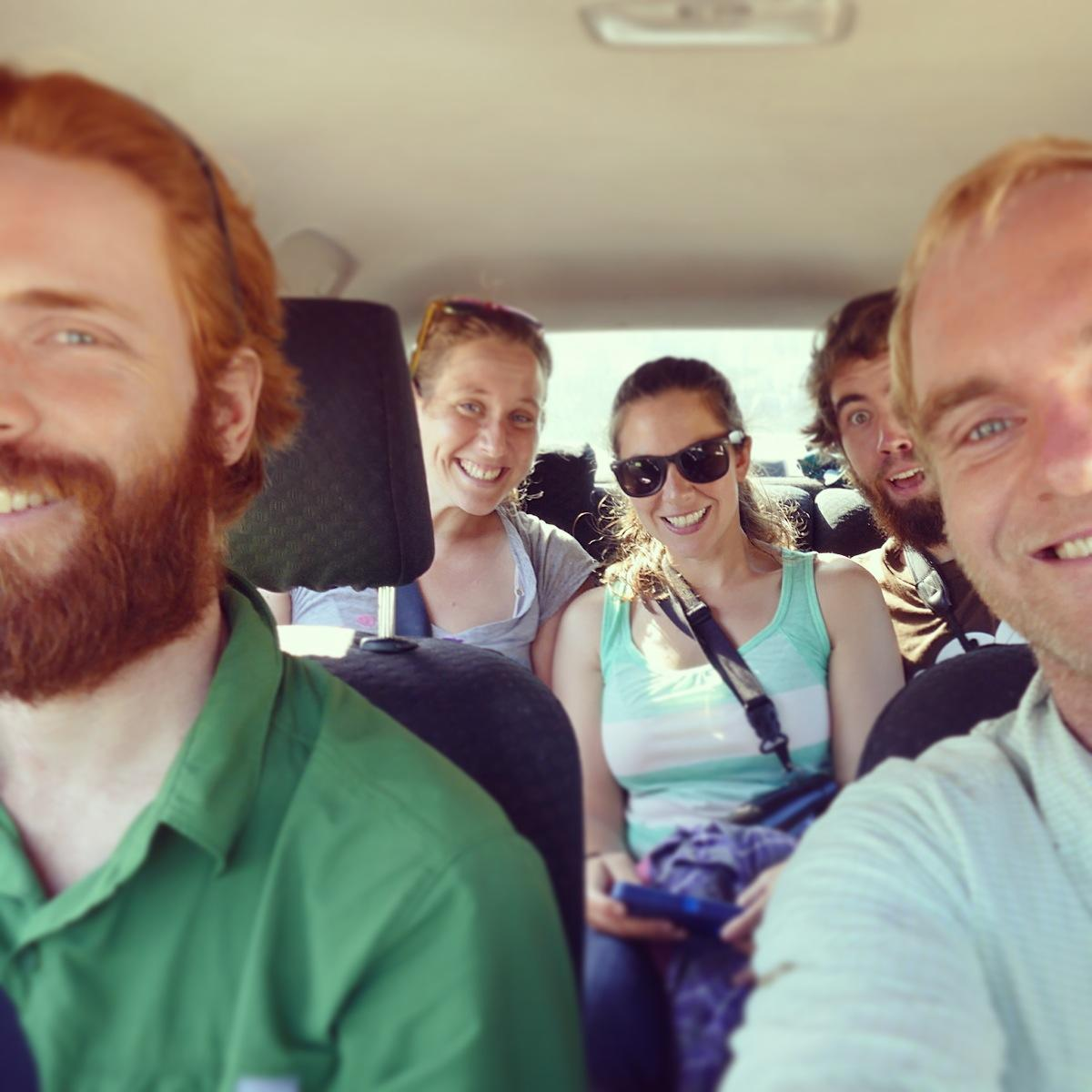 Jay and Noah (front) and Barbara, Liz, and Tom (back) ride toward the next birding spot. Noah Strycker