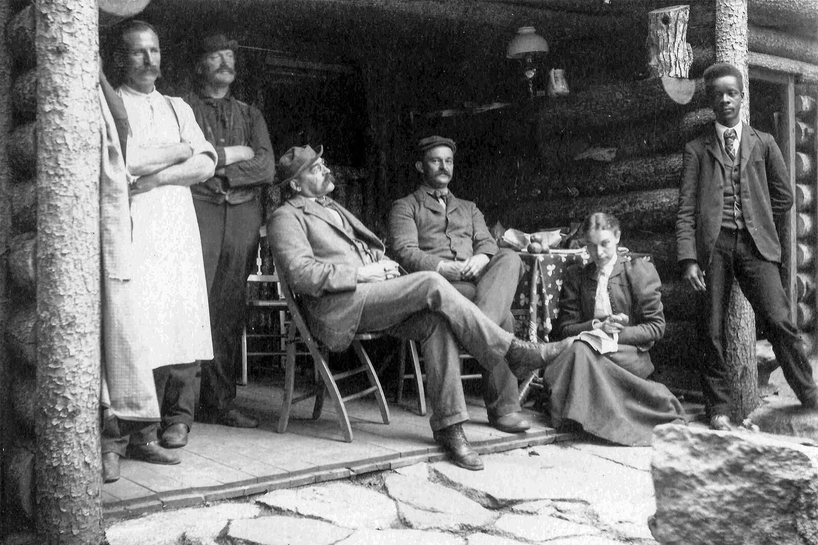Robert A. Gilbert, far right, at William Brewster's cabin at Pine Point, Umbagog Lake, Maine. Mass Audubon Collection