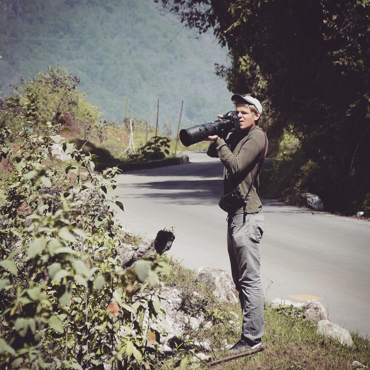 John Cahill photographs birds in Guatemala's western highlands. Noah Strycker