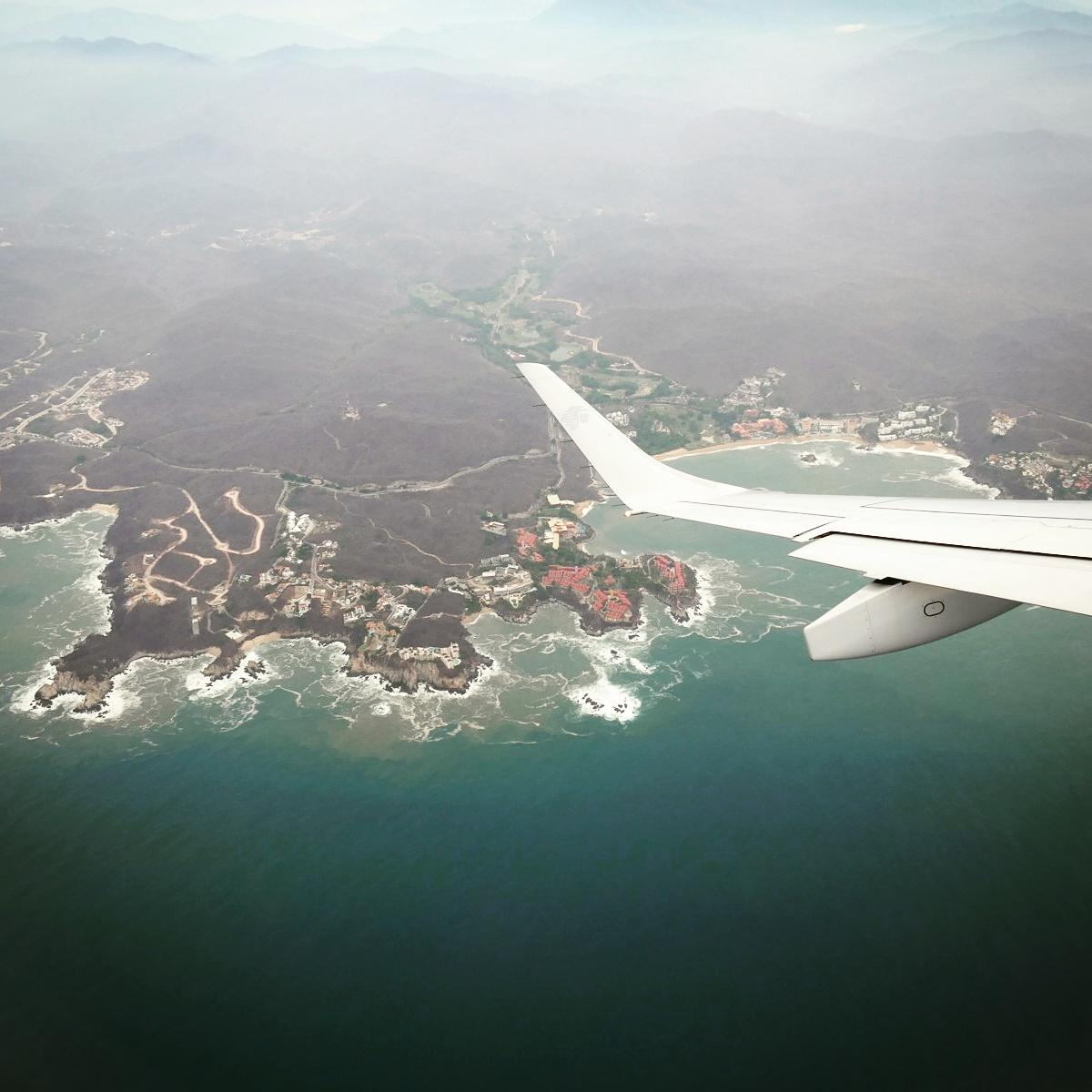 The small town of Huatulco, on Mexico's southern Pacific coast, appears under the wingtip. Noah Strycker