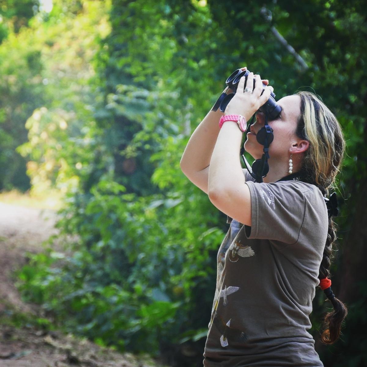 Jilly spots birds along a dirt road in Oaxaca's Atlantic lowlands. Noah Strycker