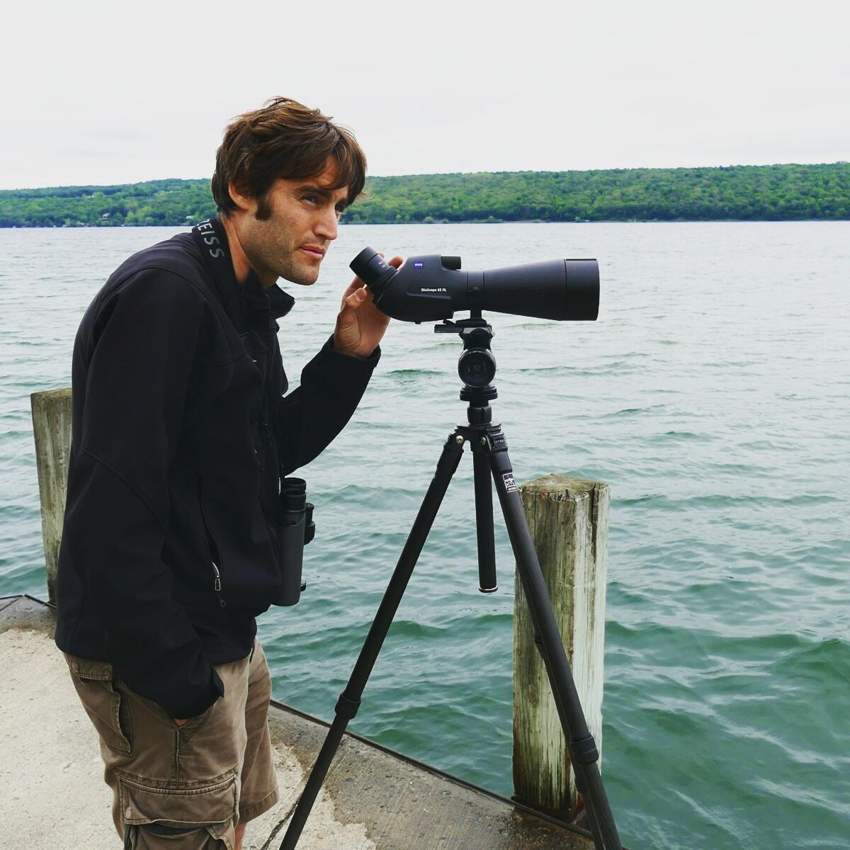 Tim Lenz searches for a Brown Pelican on Cayuga Lake near Ithaca. Noah Strycker