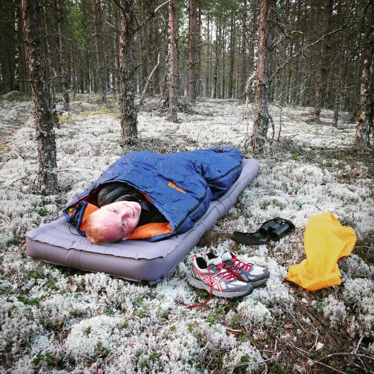 Noah settles in for the night in the pine forest. Noah Strycker