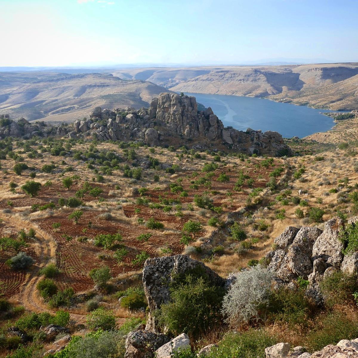 The Euphrates River winds between castle-like rock formations in southern Turkey. Noah Strycker