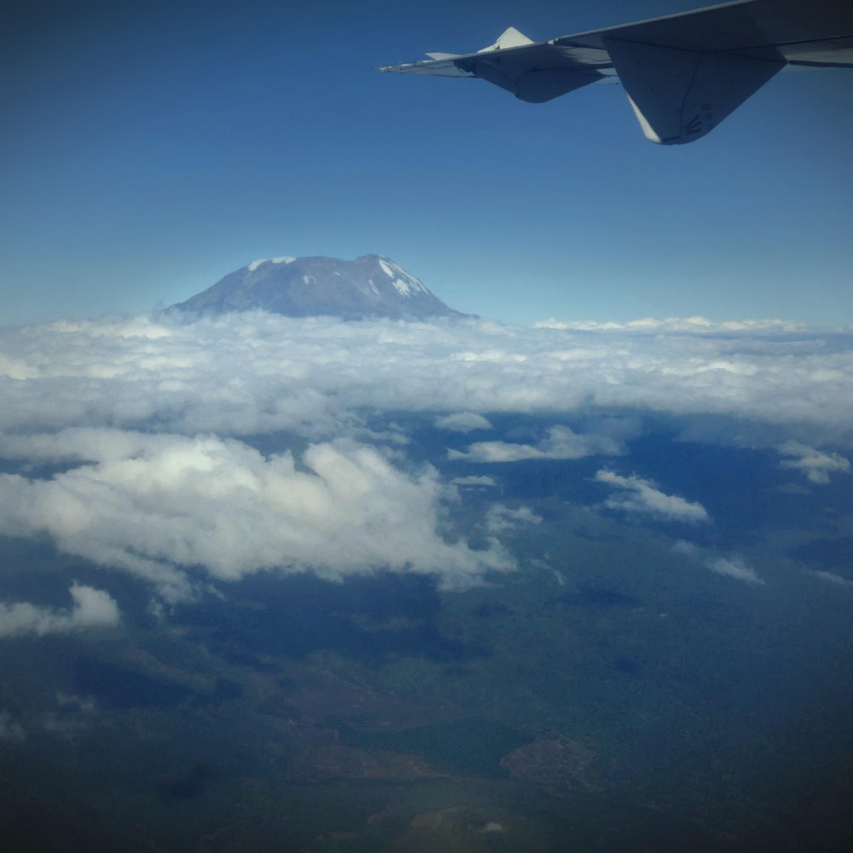 Mount Kilimanjaro passes under the wingtip as Noah leaves Kenya.