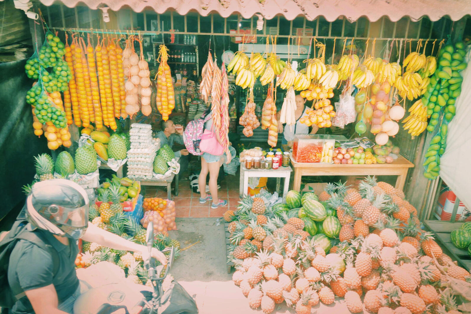 A roadside fruit stand, viewed from the bus. Noah Strycker