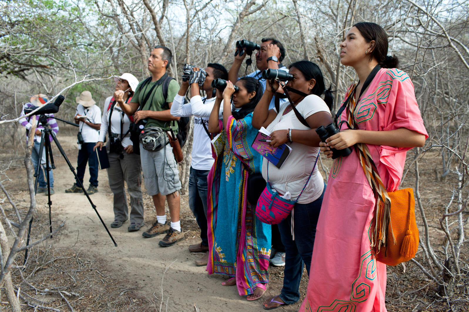 Wayuu indigenous students and teacher Alvaro Jaramillo are bird watching in La Guajira, Colombia this past June. The program teaches locals to become tour guides for travelers interested in spotting birds. Carlos Villalon