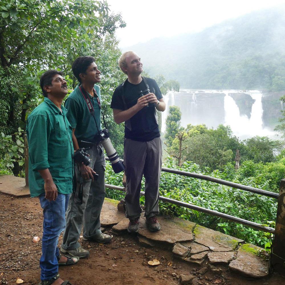 Noah hangs out with local birders near Vazhachal. Noah Strycker