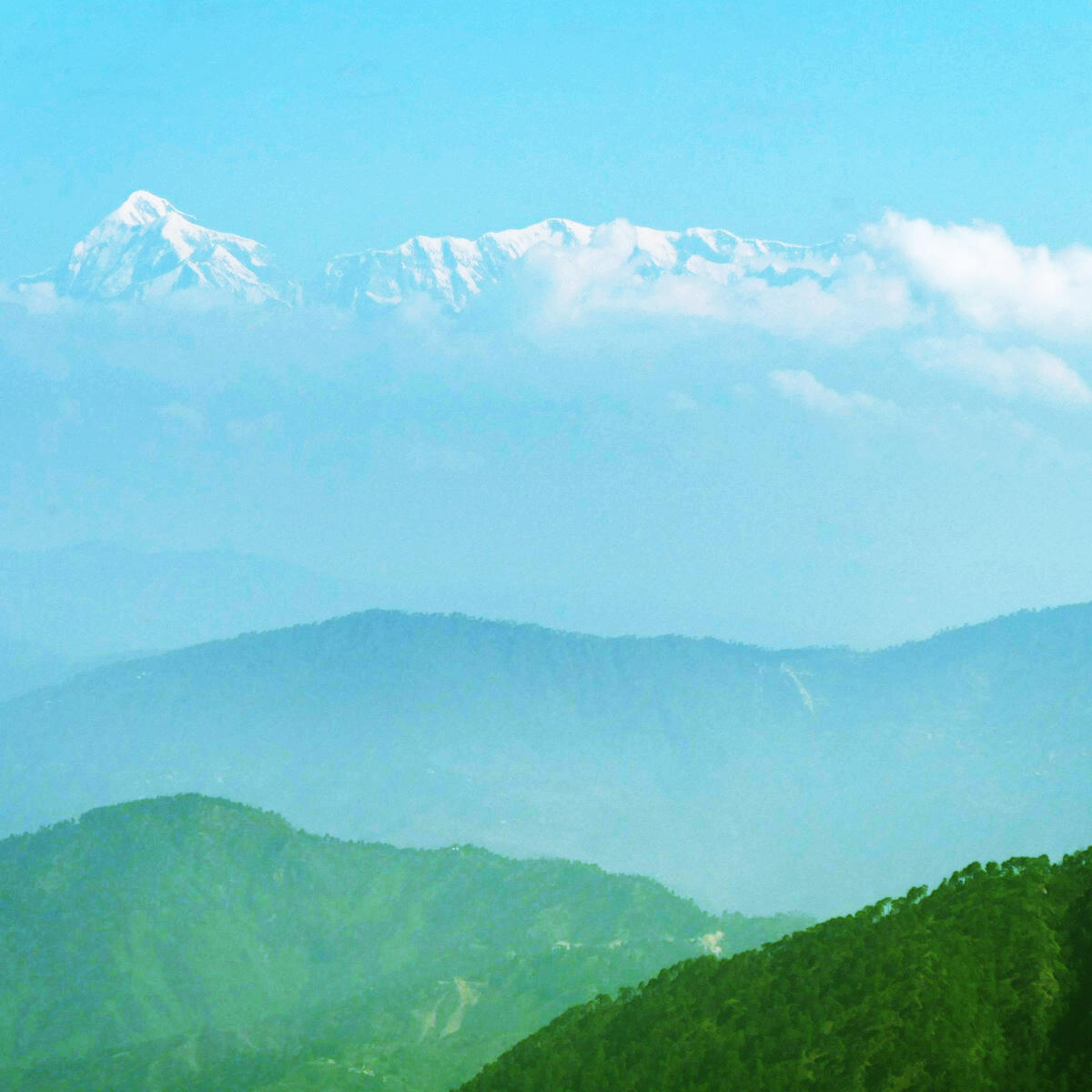 Summits of Himalayan peaks are visible in the distance: The mountain on the left is Trishul, at 23,496 feet. Noah Strycker