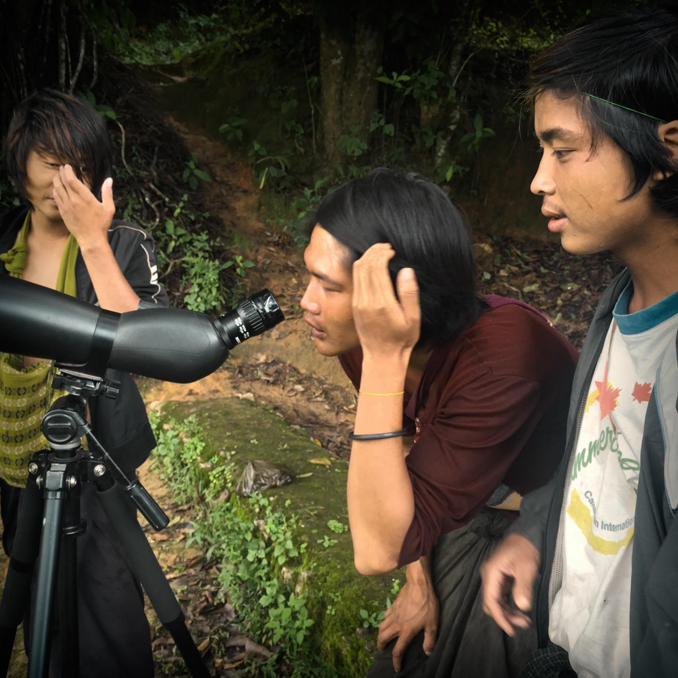 Curious locals take a look through Gideon's spotting scope. Noah Strycker