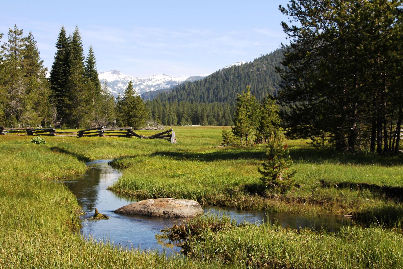 Framed by 9,000-foot peaks in Lassen Volcanic National Park, Gurnsey Creek flows through Childs Meadow, which is being restored to understand how wetlands capture and store carbon. Jane Braxton Little