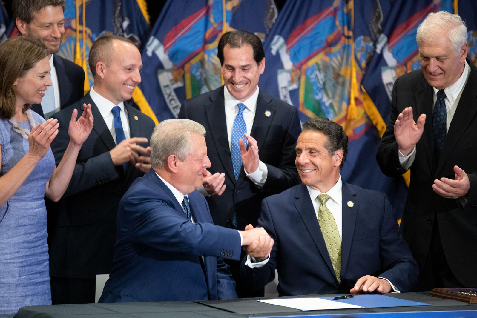 Former Vice President Al Gore, left, shakes New York Governor Andrew Cuomo's hand after Cuomo signed the Climate Leadership and Community Protection Act at Fordham Law School July 18, 2019 in Manhattan, New York. Luke Franke/Audubon
